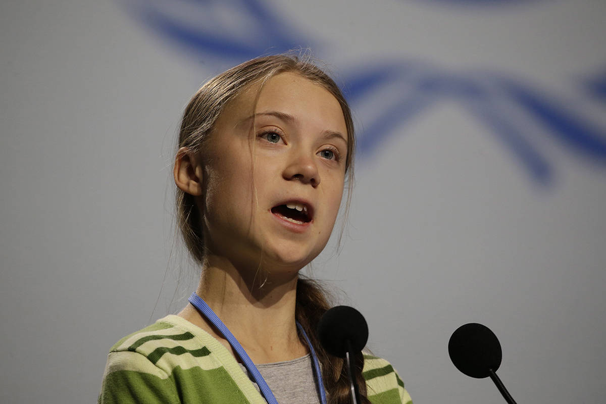 Swedish climate activist Greta Thunberg addresses plenary of U.N. climate conference during with a meeting with leading climate scientists at the COP25 summit in Madrid, Spain, Wednesday, Dec. 11, 2019. (AP Photo/Paul White)