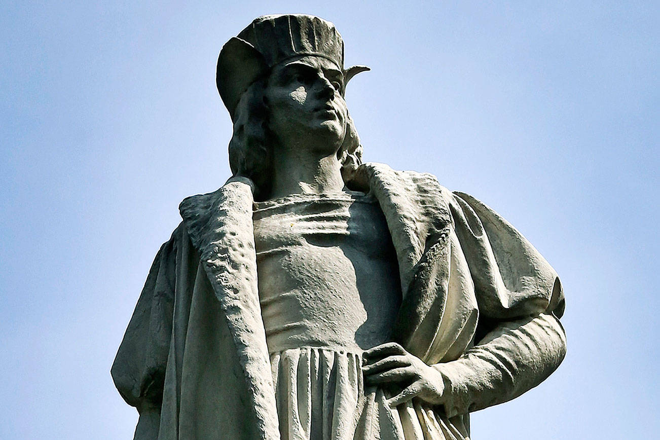In this Aug. 27, 2017 photo, the Christopher Columbus statue stands at Manhattan's Columbus Circle in New York. A movement to abolish Columbus Day and replace it with Indigenous Peoples Day has new momentum but the gesture to recognize victims of European colonialism has also prompted howls of outrage from some Italian Americans, who say eliminating their festival of ethnic pride is culturally insensitive, too. (AP Photo/Bebeto Matthews)