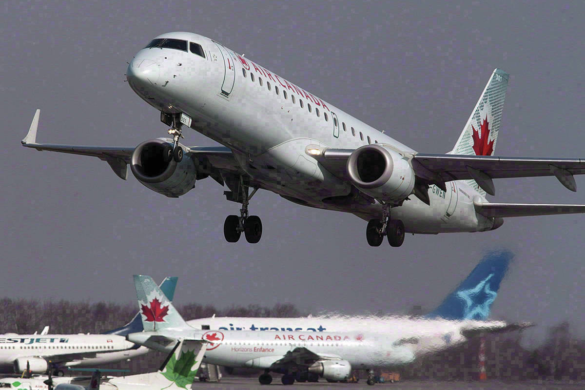 An Air Canada jet takes off from Halifax Stanfield International Airport in Enfield, N.S. on Thursday, March 8, 2012. Canadian airlines must now offer more compensation to passengers for inconveniences. (THE CANADIAN PRESS/Andrew Vaughan)