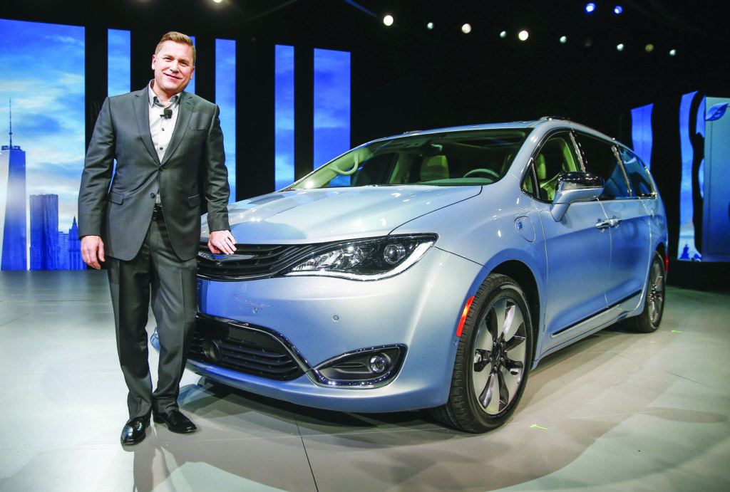 Tim Kuniskis, head of passenger car brands for Fiat Chrysler, poses with the 2017 Chrysler Pacifica Hybrid, at the North American International Auto Show at Cobo Center in Detroit, Michigan, USA, 11 January 2016. Auto manufacturers from around the globe come to show off their latest models and concepts. EPA/TANNEN MAURY
