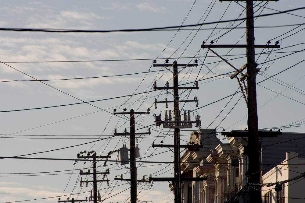 Telephone poles and power lines over a San Francisco street. (Courtesy image)