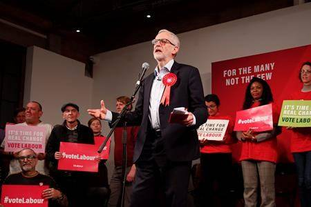 Labour Leader Jeremy Corbyn addresses an eve of poll rally in London, Wednesday, Dec. 11, 2019. (AP Photo/Thanassis Stavrakis)