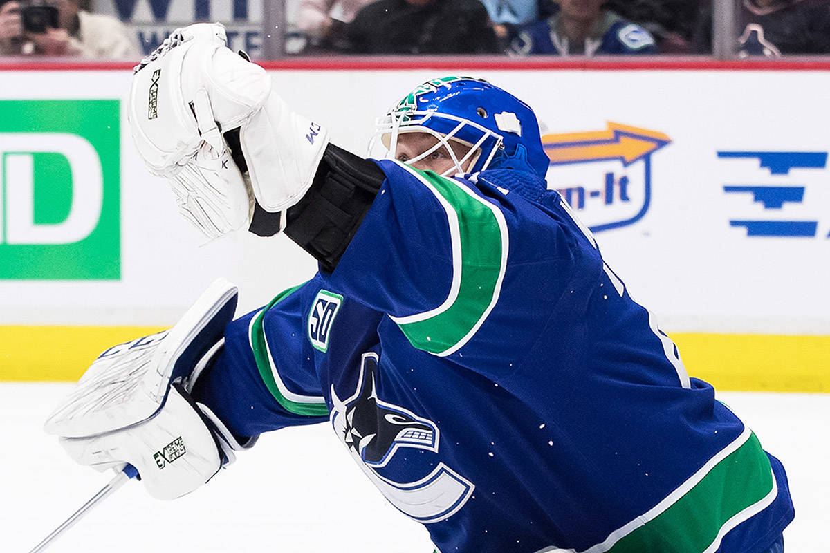 Vancouver Canucks goalie Jacob Markstrom, of Sweden, makes a glove save against the Carolina Hurricanes during the first period of an NHL hockey game in Vancouver, on Thursday December 12, 2019. THE CANADIAN PRESS/Darryl Dyck