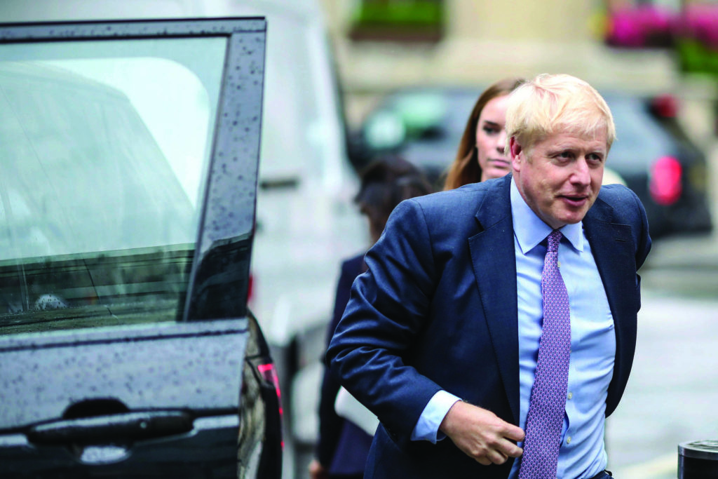 British Conservative party leadership contender Boris Johnson arrives for a live TV debate in central London Tuesday, June 18, 2019. Britain's Conservative Party is holding a contest to replace Prime Minister Theresa May, and party legislators will continue to hold elimination votes until the final two contenders will be put to a vote of Conservative Party members nationwide, with the winner due to become Conservative Party leader and prime minister. (AP Photo/Vudi Xhymshiti)