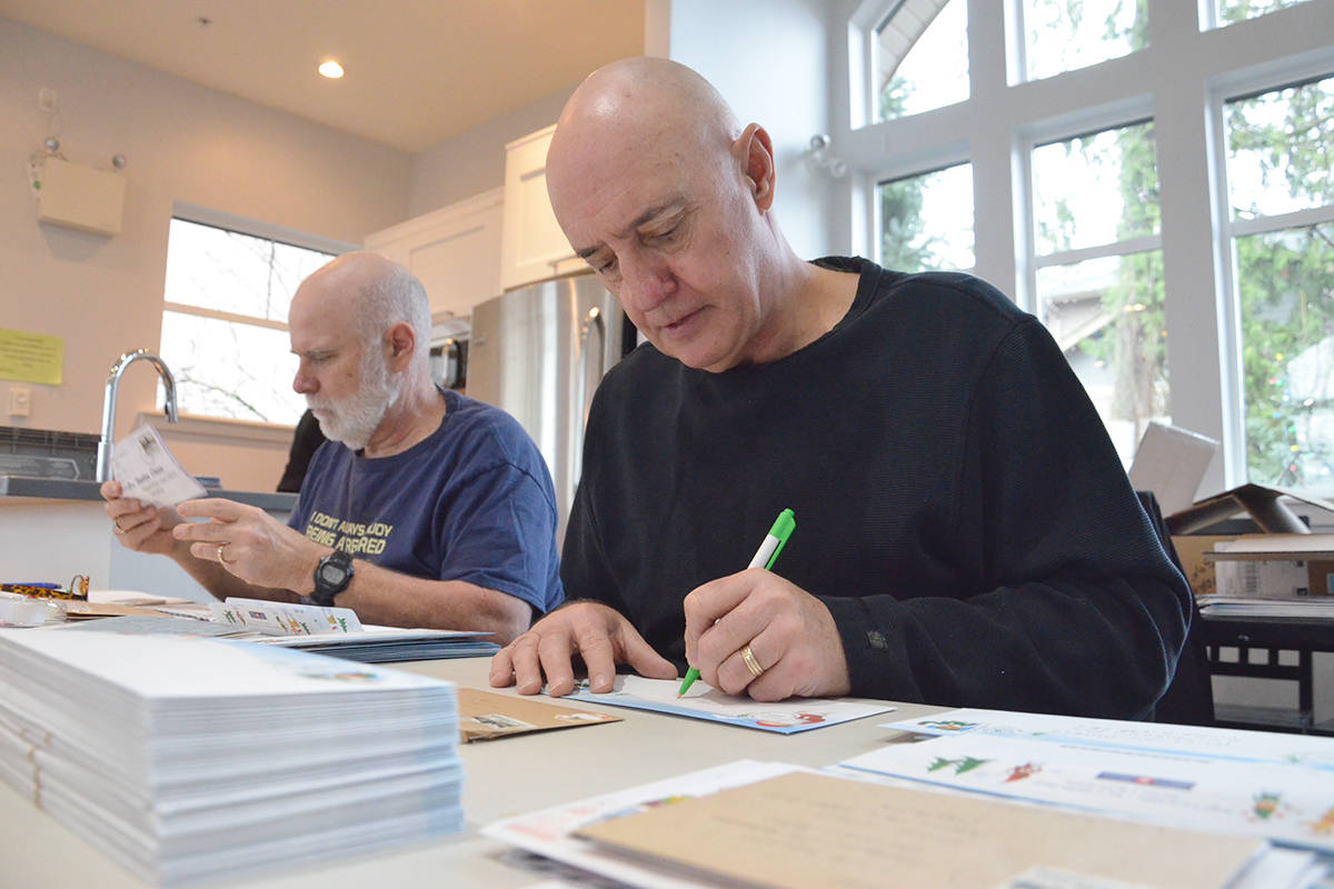 Langley's postal elves include Steve Pasacreta and Rick Cowie. (Heather Colpitts/Langley Advance Times)