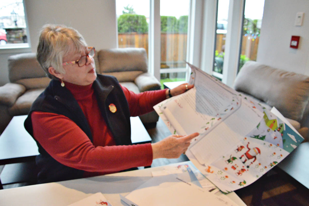 Canada Post provides stationary for the postal elves, including a large poster that is sent to school classes. The Langley group, which includes Anita Folk, will send out hundreds of posters each Christmas. (Heather Colpitts/Langley Advance Times)