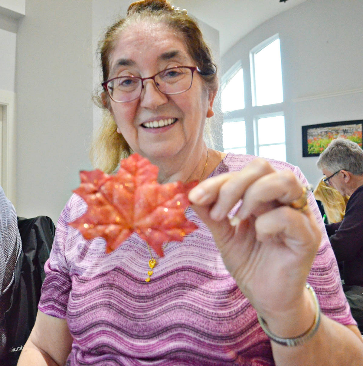 Postal elves such as Sharon Svensrud have taken to sending back small maple leaves to international letter writers. Many who write to Santa from abroad ask for leaves. (Heather Colpitts/Langley Advance Times)