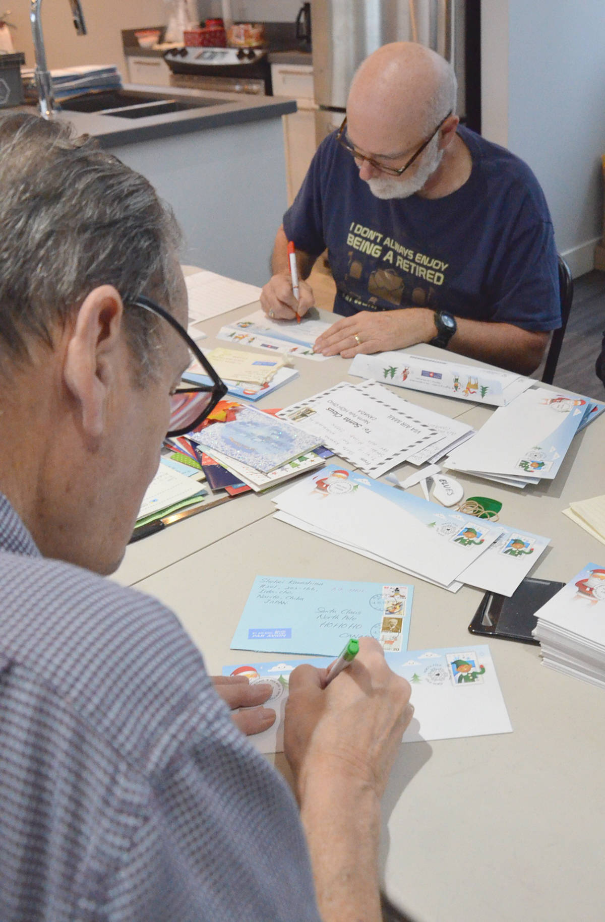 Bruce Mavis and Steve Pasacreta are local volunteers who help with letters to Santa. (Heather Colpitts/Langley Advance Times)