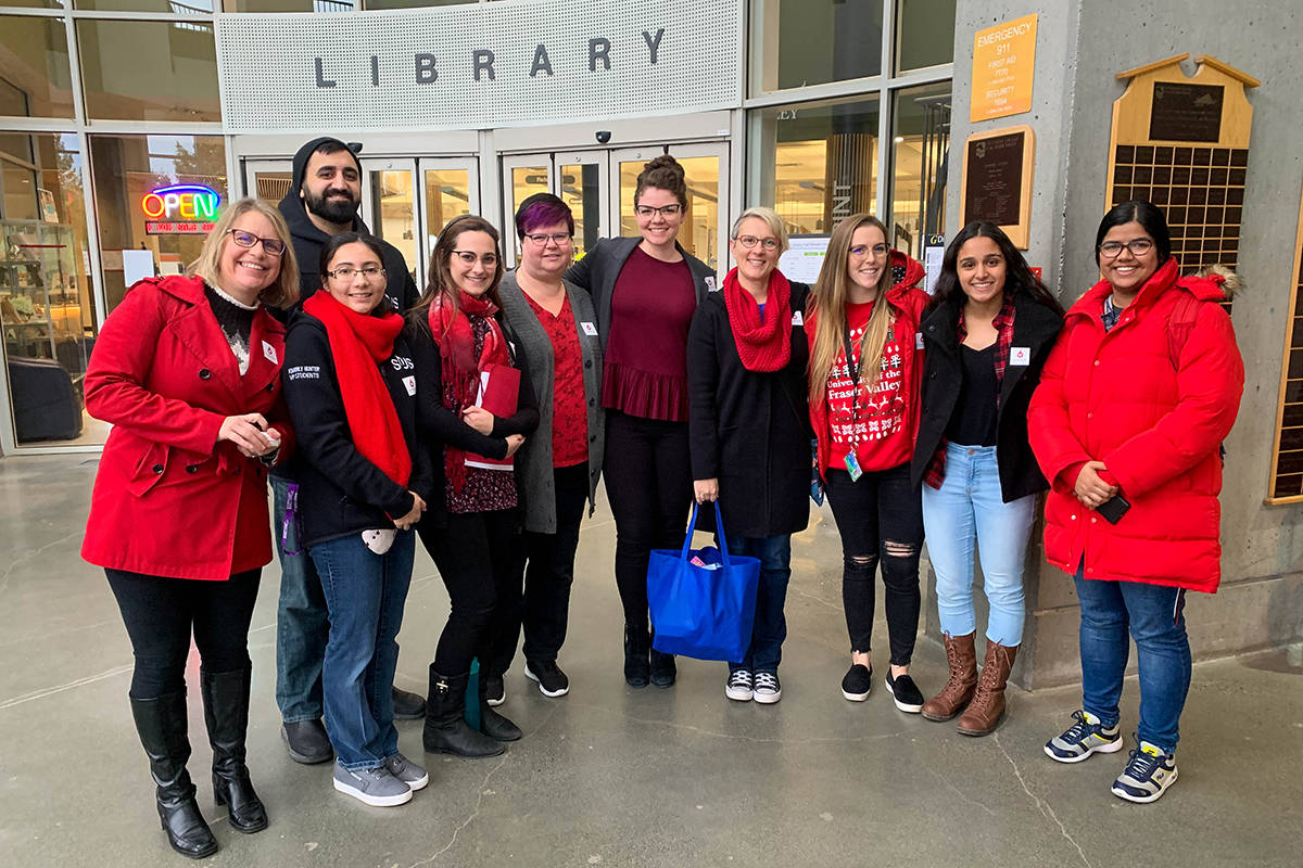 Members of the UFV Student Union Society and the Faculty Staff Association dressed in red on Tuesday before delivering their petition to UFV president to Joanne MacLean. (Submitted photo)