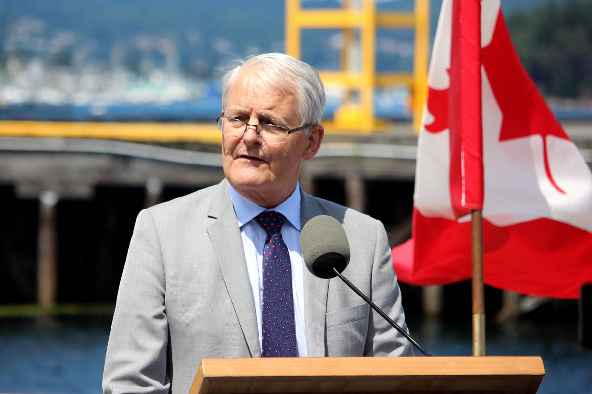 Marc Garneau, minister of transportation and infrastructure, speaks during a funding announcement on Wednesday at the Port of Nanaimo's cruise ship terminal. Garneau announced that the federal government is investing $46.2 million to expand the Nanaimo Port Authority's Duke Point operations.