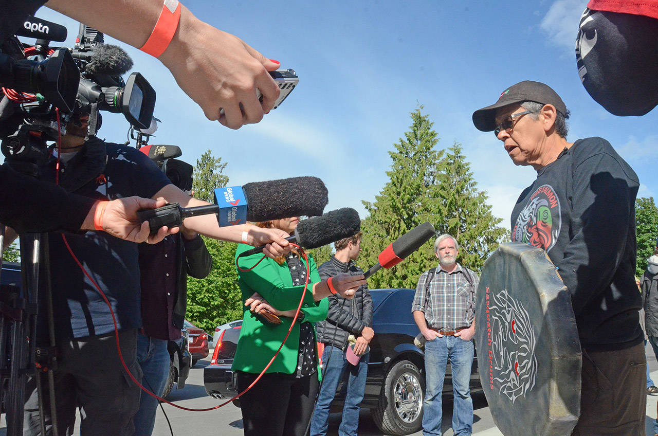 Skwah elder Eddie Gardner speaks with reporters outside Cheam First Nation where a meeting with PM Justin Trudeau was taking place, near Chilliwack, on June 5, 2018. (Paul Henderson/ The Progress)