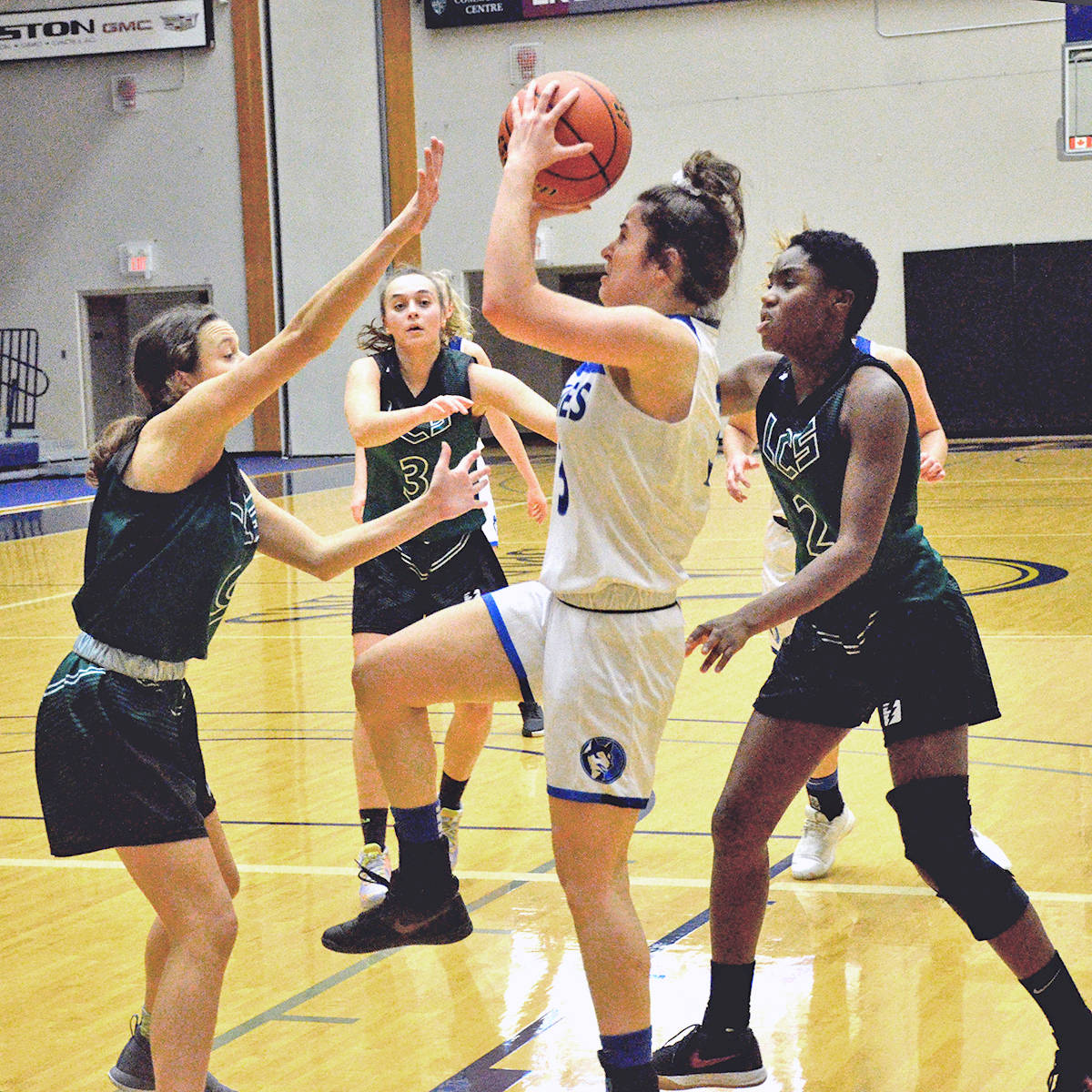 Okanagan Mission Huskies used their height inside to thwart the Langley Christian Lightning in the first semi-final of the Tsumura Invitational at Langley Events centre on Froday, Dec. 13. (Gary Ahuja/Langley Events centre)