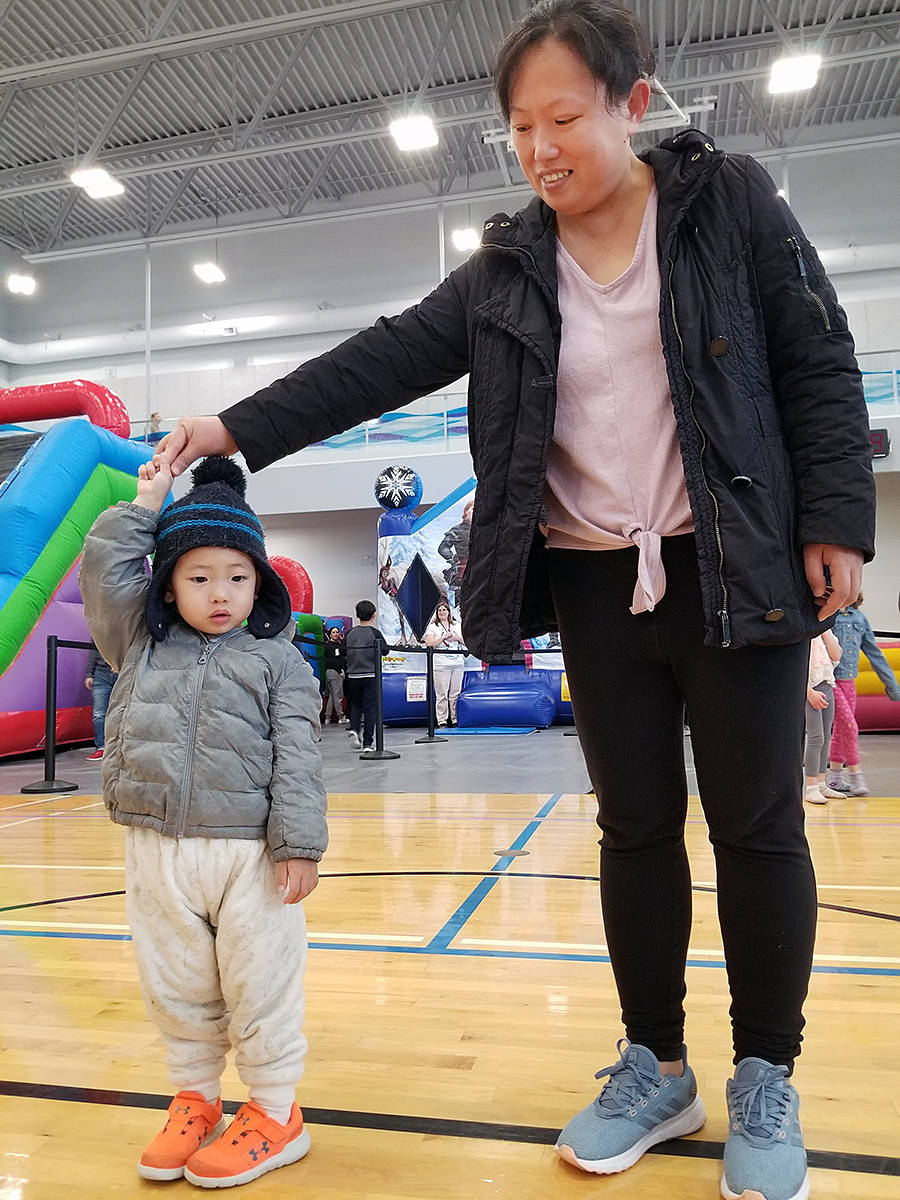 This is about as far from Mom that one young participant was willing to be at the Saturday, Dec. 14 at the annual 'holiday chaos' event at the Timms community centre in Langley City. (Dan Ferguson/Langley Advance Times)
