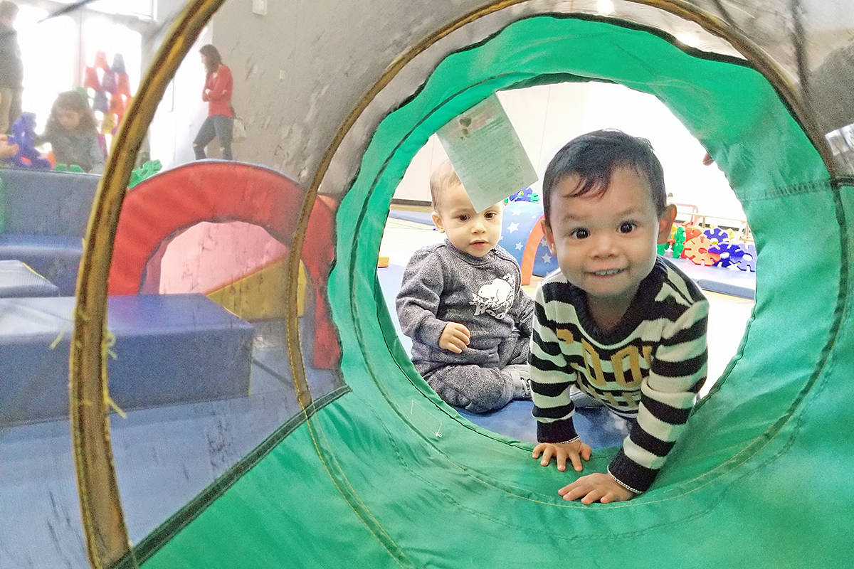 Ethan Draude, two, checked out a tunnel that was part of a kid-friendly obstacle course at Timms Centre on Saturday, Dec. 14 during the annual 'holiday chaos' event at the Timms community centre in Langley City. (Dan Ferguson/Langley Advance Times)