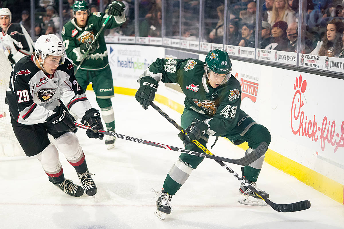 Giants defenceman Tanner Brown tangled with a Silvertip Saturday night (Dec. 15) in Everett (Chris Mast/special to Langley Advance Times)