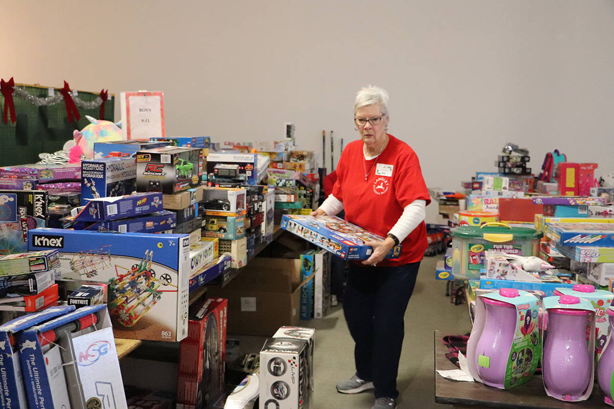 Volunteers at the Langley Christmas Bureau organize toys for the nearly 1,800 children the local charity supports each holiday season. (Joti Grewal - Langley Advance Times)