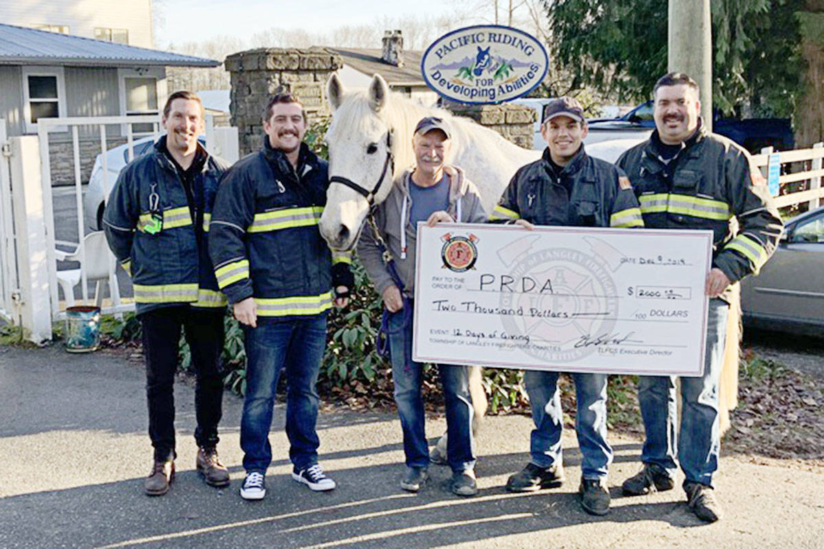 Langley Township firefighters donated money to Pacific Riding for Developing Abilities, one of a dozen charities getting funding and attention during their 12 Days of Giving event. (TLFCS/Special to the Langley Advance Times)