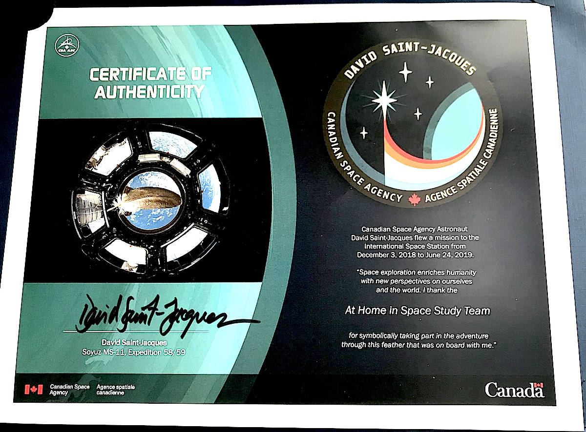 The eagle feather can be seen floating weightlessly in space in a photo snapped on the International Space Station by Canadian astronaut David Saint-Jacques. (Jennifer Feinberg/ The Progress