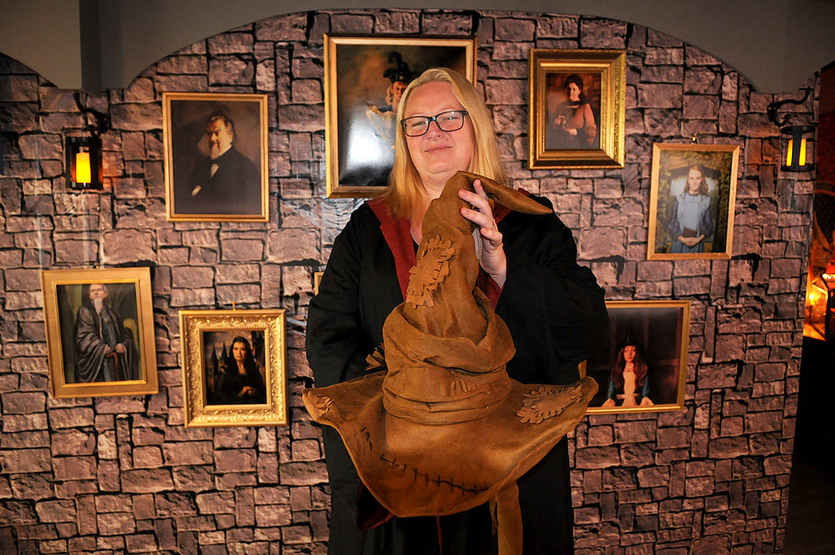 Katrharine Wall holds up the Sorting Hat that people can wear when they visit her Harry Potter themed house this Christmas. (Jenna Hauck/ The Progress)