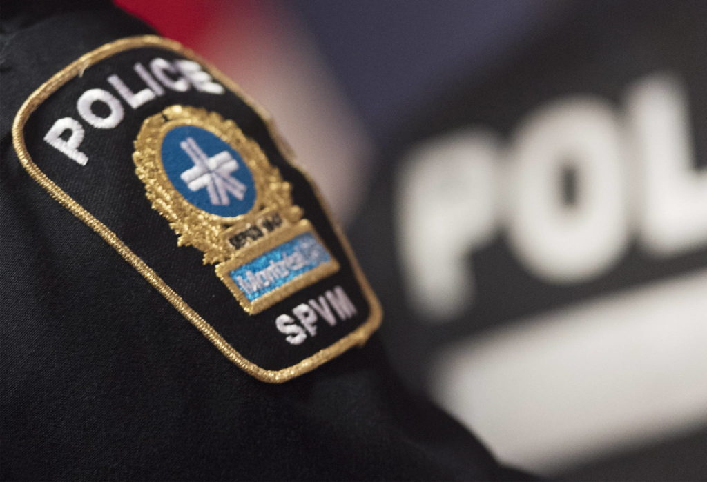 A Montreal Police badge is shown during a news conference in Montreal, Monday, October 7, 2019. Quebec's human rights commission says Montreal police must definitively end the practice of routine street checks. THE CANADIAN PRESS/Graham Hughes