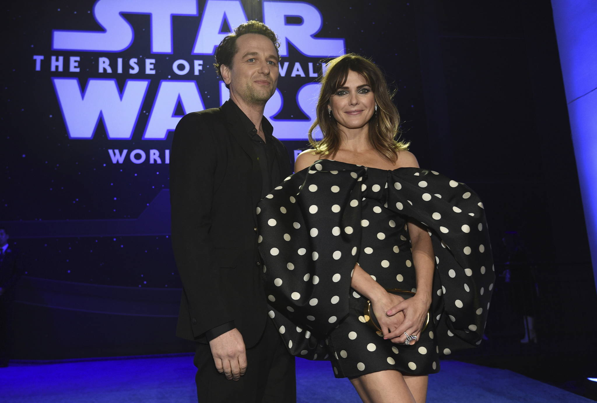 """Matthew Rhys, left, and Keri Russell arrive at the world premiere of """"Star Wars: The Rise of Skywalker"""" on Monday, Dec. 16, 2019, in Los Angeles (AP Photo/Chris Pizzello)"""