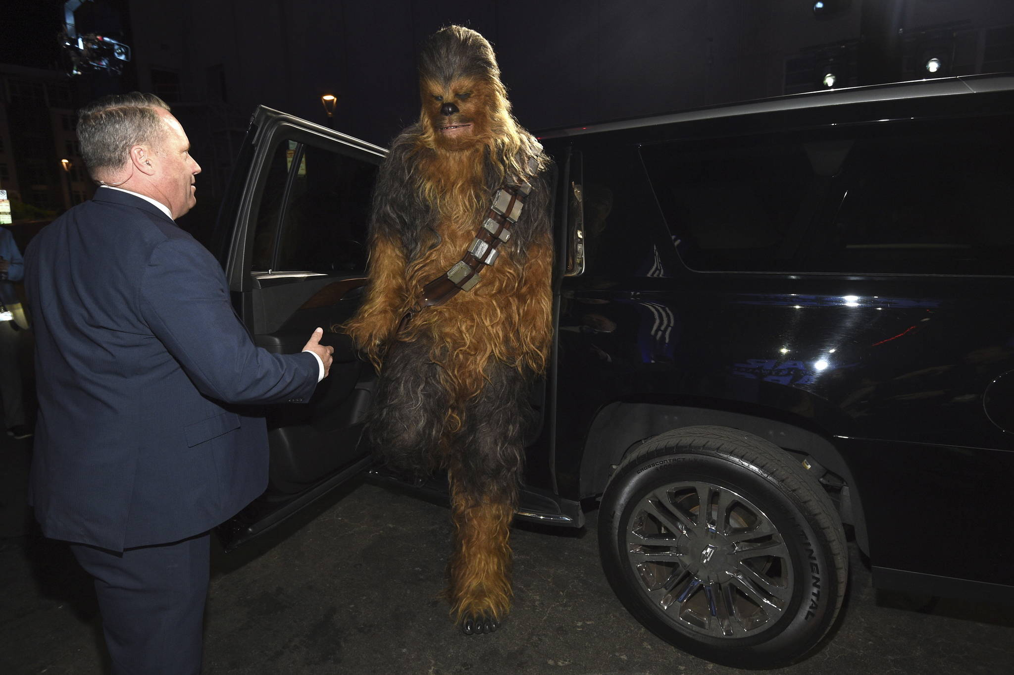 """A Chewbacca character exits a car as he arrives at the world premiere of """"Star Wars: The Rise of Skywalker"""" on Monday, Dec. 16, 2019, in Los Angeles (AP Photo/Chris Pizzello)"""