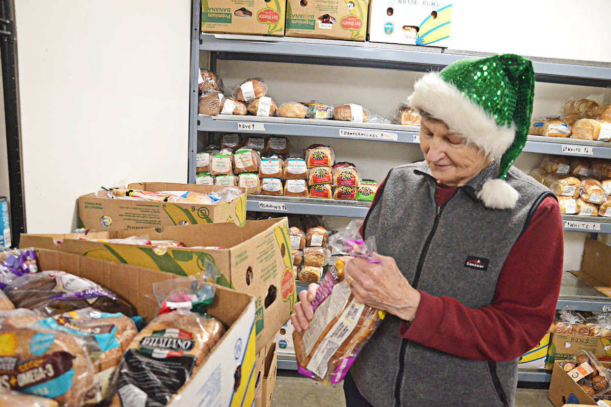 Alice Kennedy is one of the volunteers who sorts new food donations arriving at the Sources Food Bank in Langley. (Matthew Claxton/Langley Advance Times)