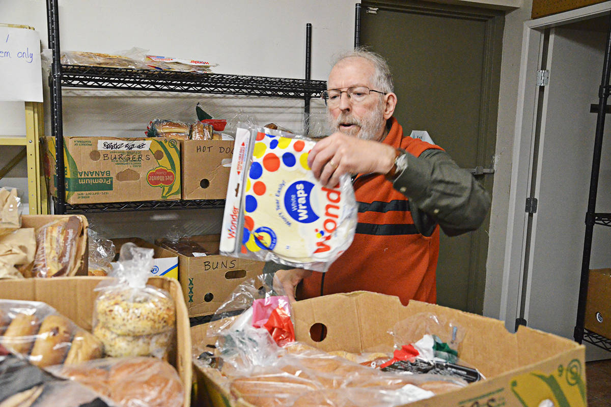 Tom McMath is a volunteer who helps sort donations at the Sources Langley Food Bank. (Matthew Claxton/Langley Advance Times)