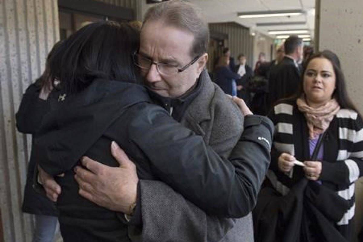 "Glen Assoun is embraced by family members at Nova Scotia Supreme Court in Halifax on March 1, 2019. Glen Assoun's lawyer says the wrongfully convicted Halifax man suffered ""every single day"" as he waited to be exonerated for a murder he didn't commit – a wait that was prolonged for months as his case sat on former justice minister Jody Wilson-Raybould's desk. THE CANADIAN PRESS/Andrew Vaughan"