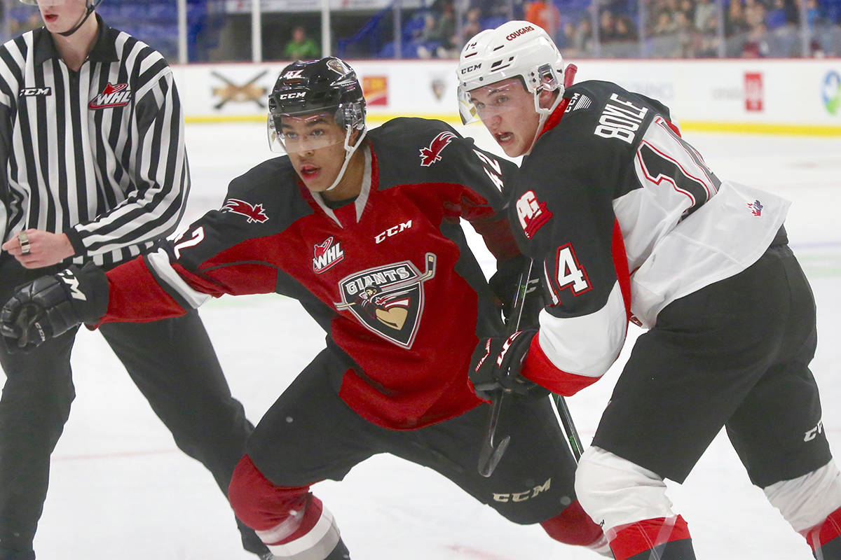 Justin Sourdif tangled with a Cougar Tuesday night (Dec. 17) at the LEC as the Vancouver Giants dropped a 3-0 decision to the Prince George Cougars. (Rik Fedyck/Vancouver Giants)