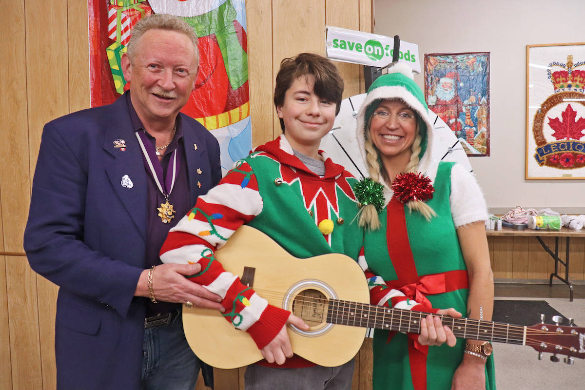 Aldergrove Elks president Guy Whitford presented 13-year-old Sam Hodgins with a brand new guitar at the Elks 25th annual Kid's Christmas Party Saturday. (Sarah Grochowski photo)