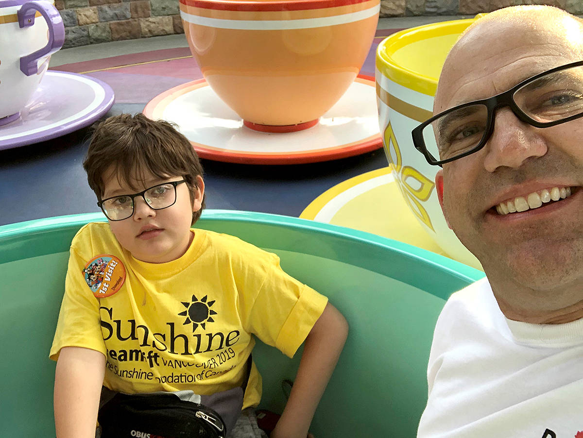 Ten-year-old Langley City boy, Thaddeus Flannigan, was partnered with Orange County Sheriff Todd Russ during his one-day trip to Disneyland with the Sunshine Foundation of Canada. (Special to the Langley Advance Times)