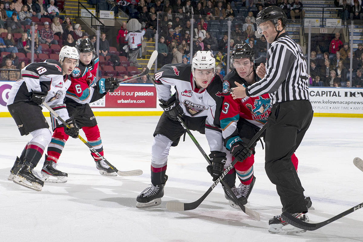 Jake Poole of the Kelowna Rockets checks Zack Ostapchuk of the Vancouver Giants at the face-off at Prospera Place on Dec. 18 in Kelowna. (Marissa Baecker/Shoot the Breeze)