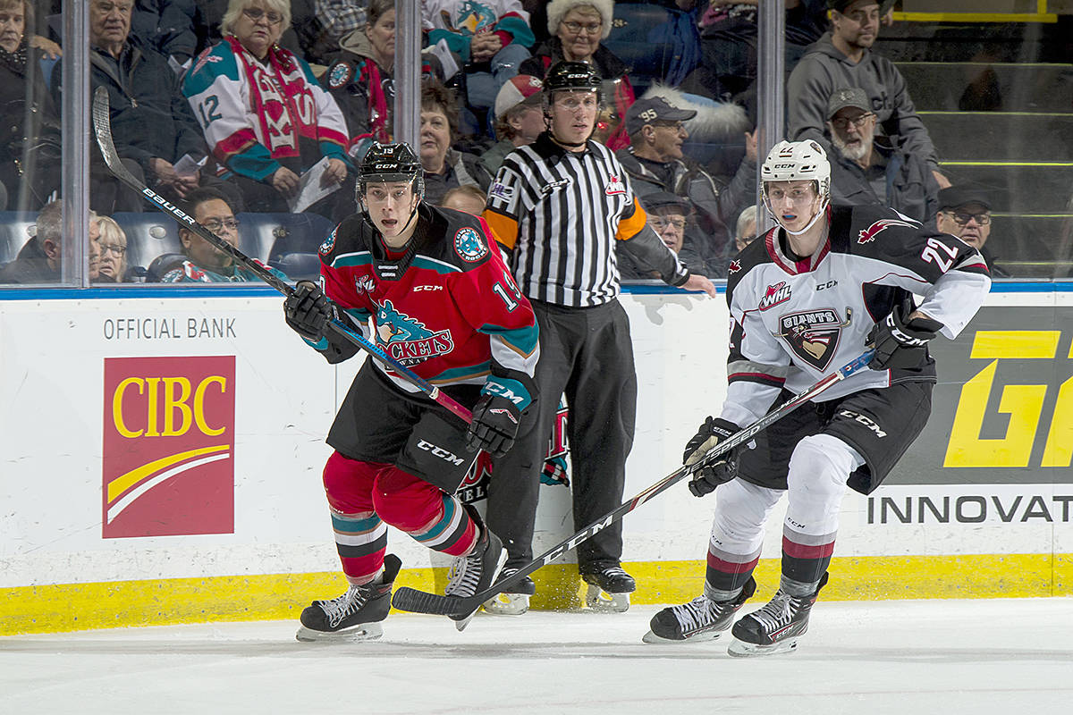 Connor Horning of the Vancouver Giants checks Ethan Ernst of the Kelowna Rockets during first period at Prospera Place on Dec. 18 in Kelowna. (Marissa Baecker/Shoot the Breeze)