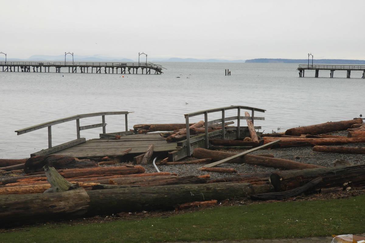 A section of the White Rock pier rests near the white rock. The debris has since been removed. (Christy Fox file photo)