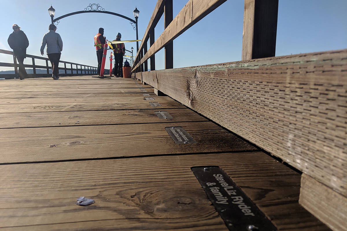 Plaques bearing donors' names have now been affixed to planks on the reopened White Rock Pier. (Aaron Hinks photo)