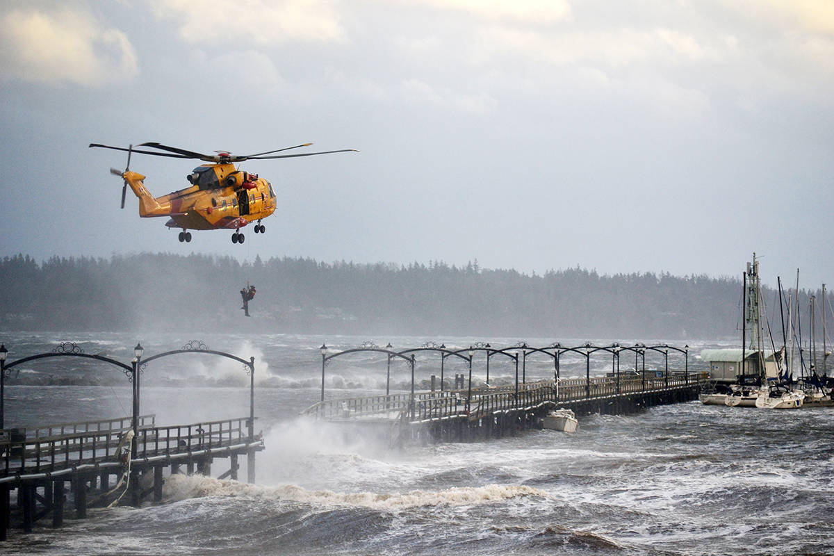 A man is rescued from the White Rock Pier after a violent windstorm contributed to destroying the mid-section of the structure Dec. 20, 2018. (Aaron Hinks file photo)