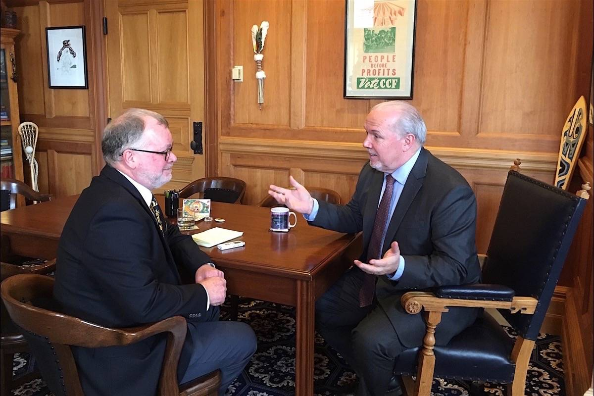 Black Press legislature reporter Tom Fletcher talks about the events of 2019 and the outlook for 2020 with B.C. Premier John Horgan, B.C. legislature, Dec. 13, 2019. (Jen Holmwood/Premier's Office)