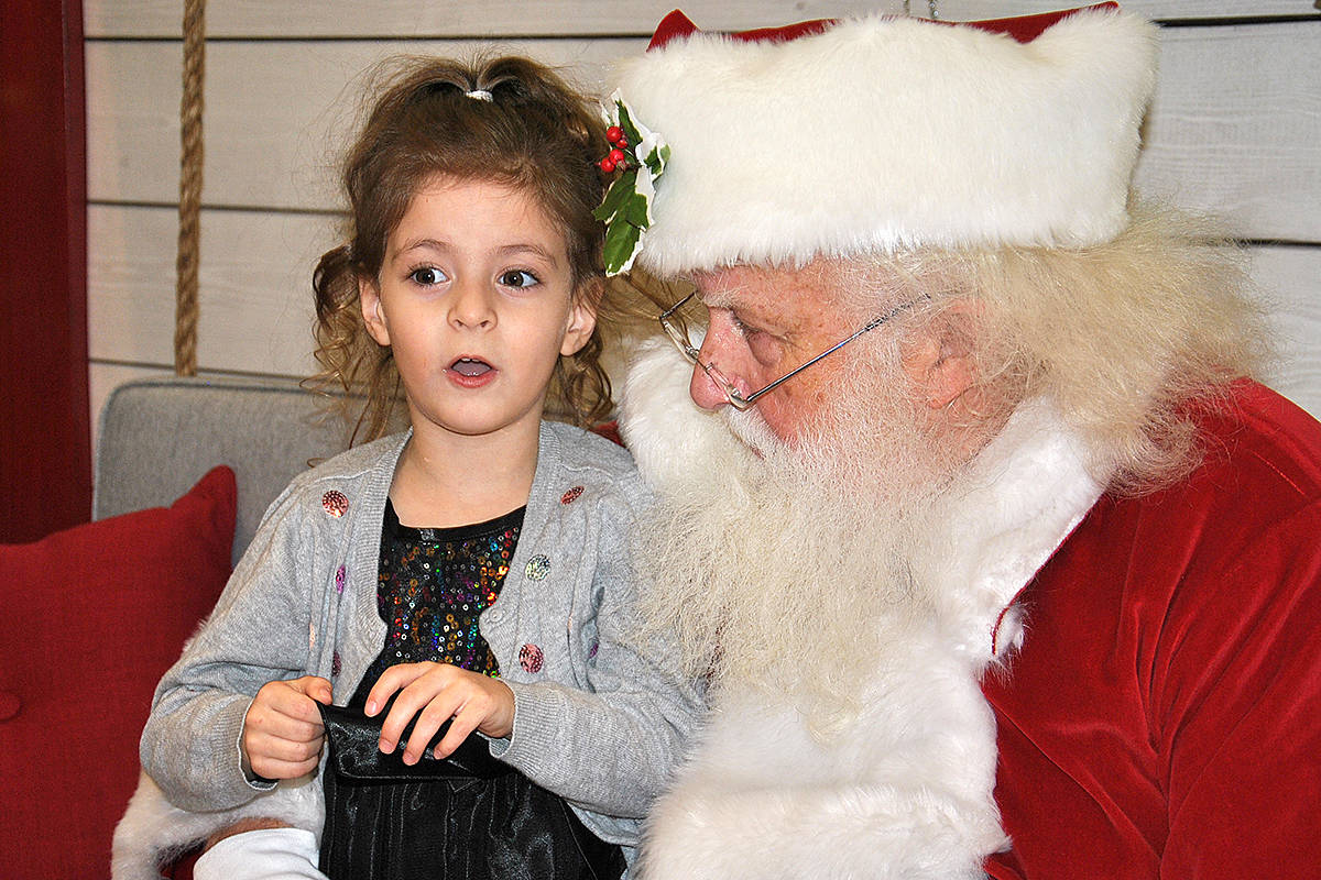 Four-year-old River Shelford, of Langley City, was animated as she explained to Santa what she wanted for Christmas. (Roxanne Hooper/Langley Advance Times)