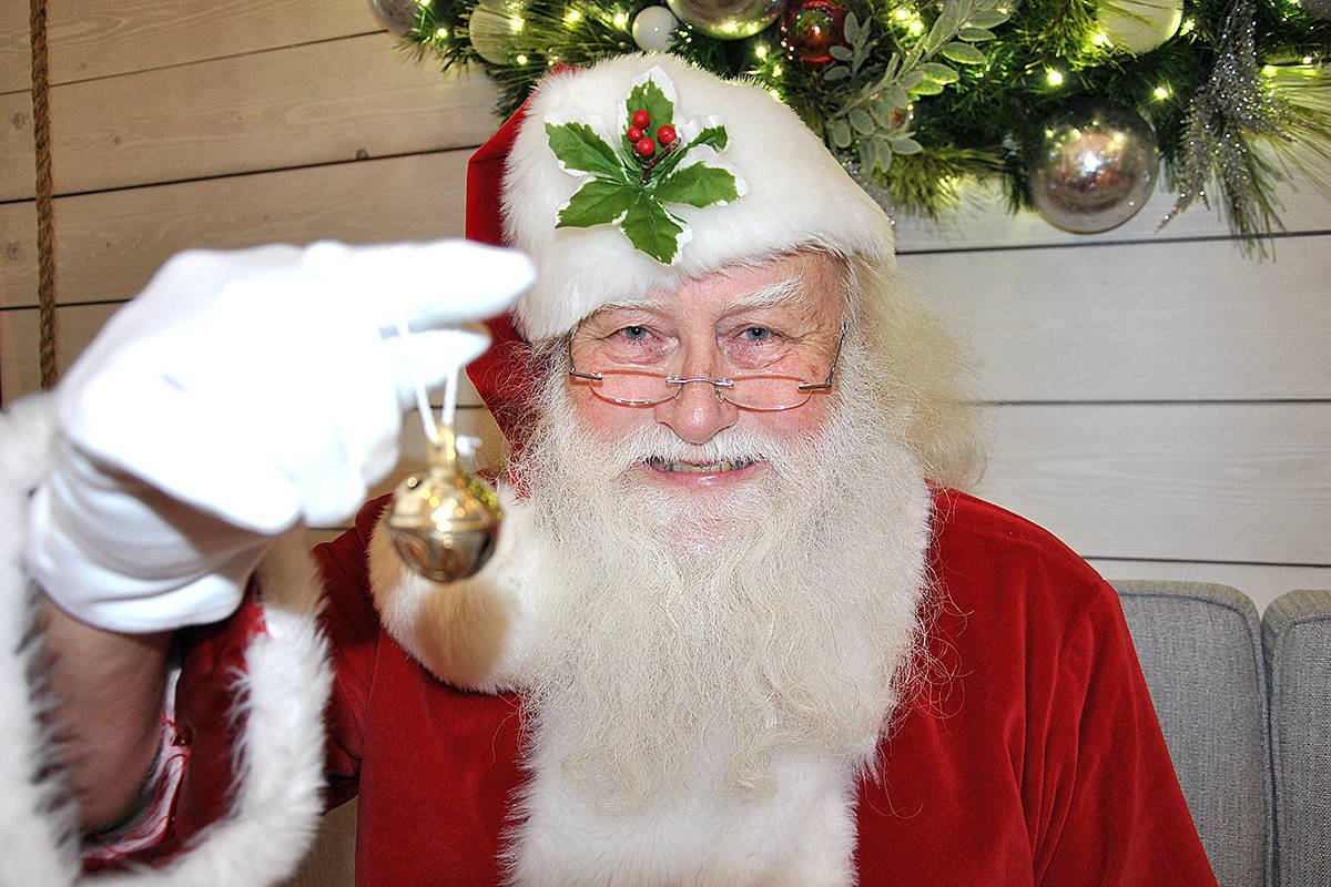 For those who fear Santa might not find them this holiday season, because they've moved or they're travelling, he has a solution. He gives those who visit him a special bell they can ring to help alert him to their new location. (Roxanne Hooper/Langley Advance Times)
