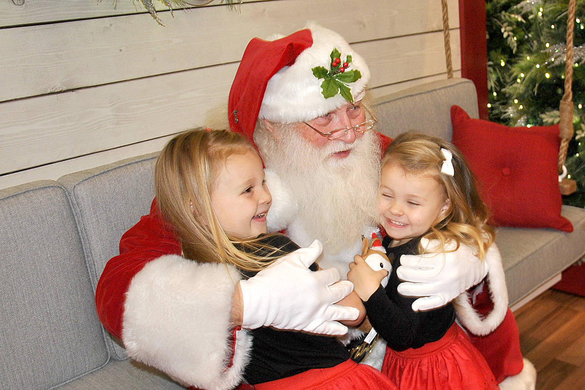 Excited to visit with the jolly ol' elf were five-year-old Madison Collins of Walnut Grove and her sisters, five-year-old Sophie and six-year-old Jennifer (not pictured). (Roxanne Hooper/Langley Advance Times)