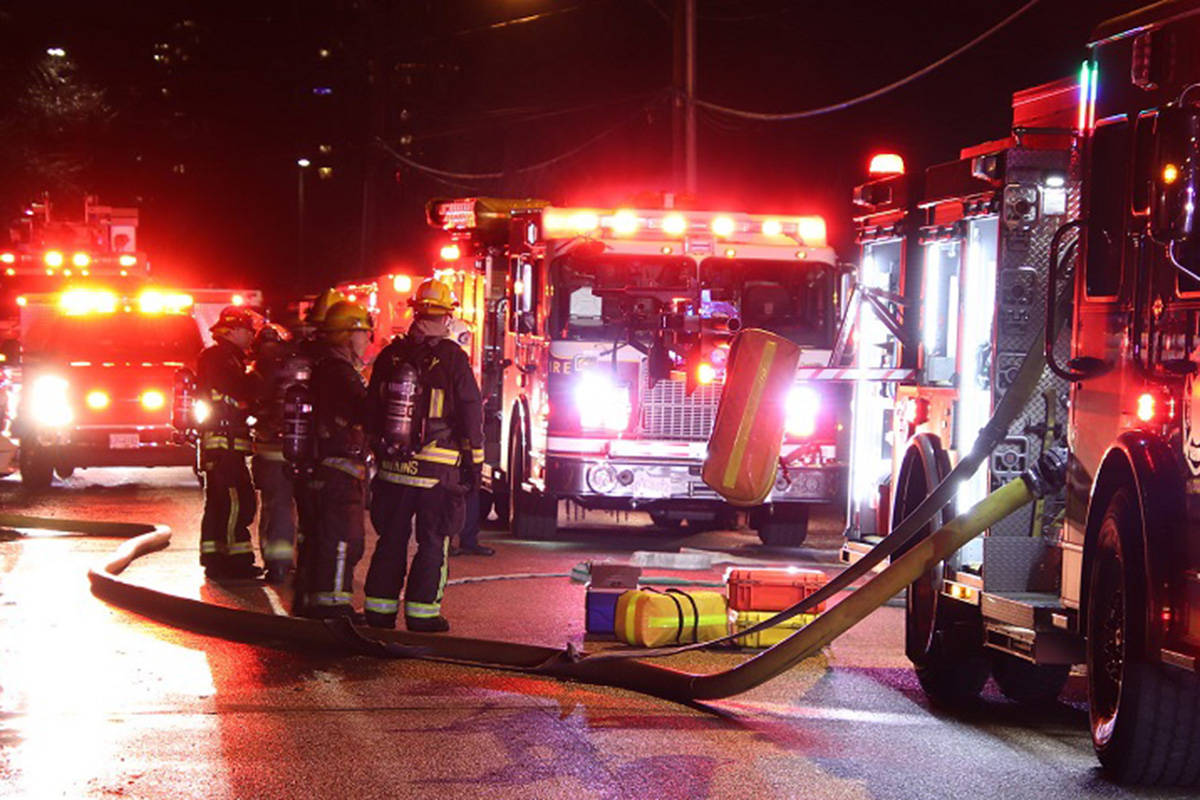 Surrey firefighters rescued a person from a burning building early Sunday morning. (Shane MacKichan photo)