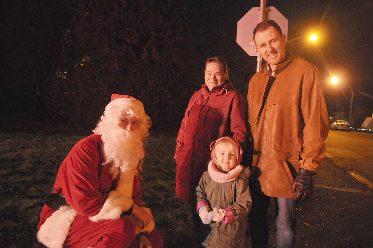 Despite a cold, two-year-old Evelyn Teichroeb waited patiently for Santa and a candy cane Sunday night (Dec. 22) (Dan Ferguson/Langley Advance Times)