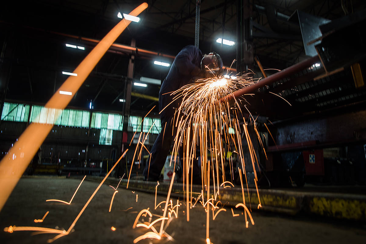 Fabricator Mike Caldarino uses a grinder on a steel stairs being manufactured for a high school in Redmond, Wash., at George Third & Son Steel Fabricators and Erectors, in Burnaby, B.C., on March 29, 2018. Canada's economy contracted slightly in October, with real gross domestic product down 0.1 per cent from September. Statistics Canada says that October's decline in GDP was the first in eight months. THE CANADIAN PRESS/Darryl Dyck