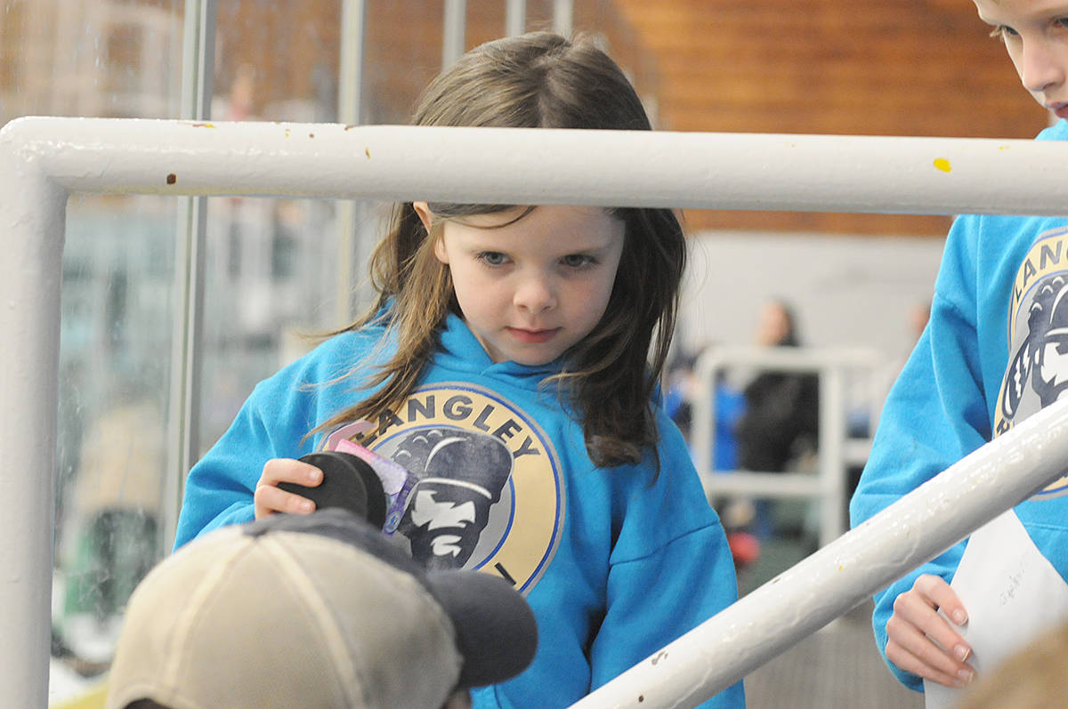 Langley Rivermen fan Amelia Addy, six, from Cloverdale, was gifted a puck at the Sunday (Dec. 22) skate at the George Preston arena (Dan Ferguson/Langley Advance Times)
