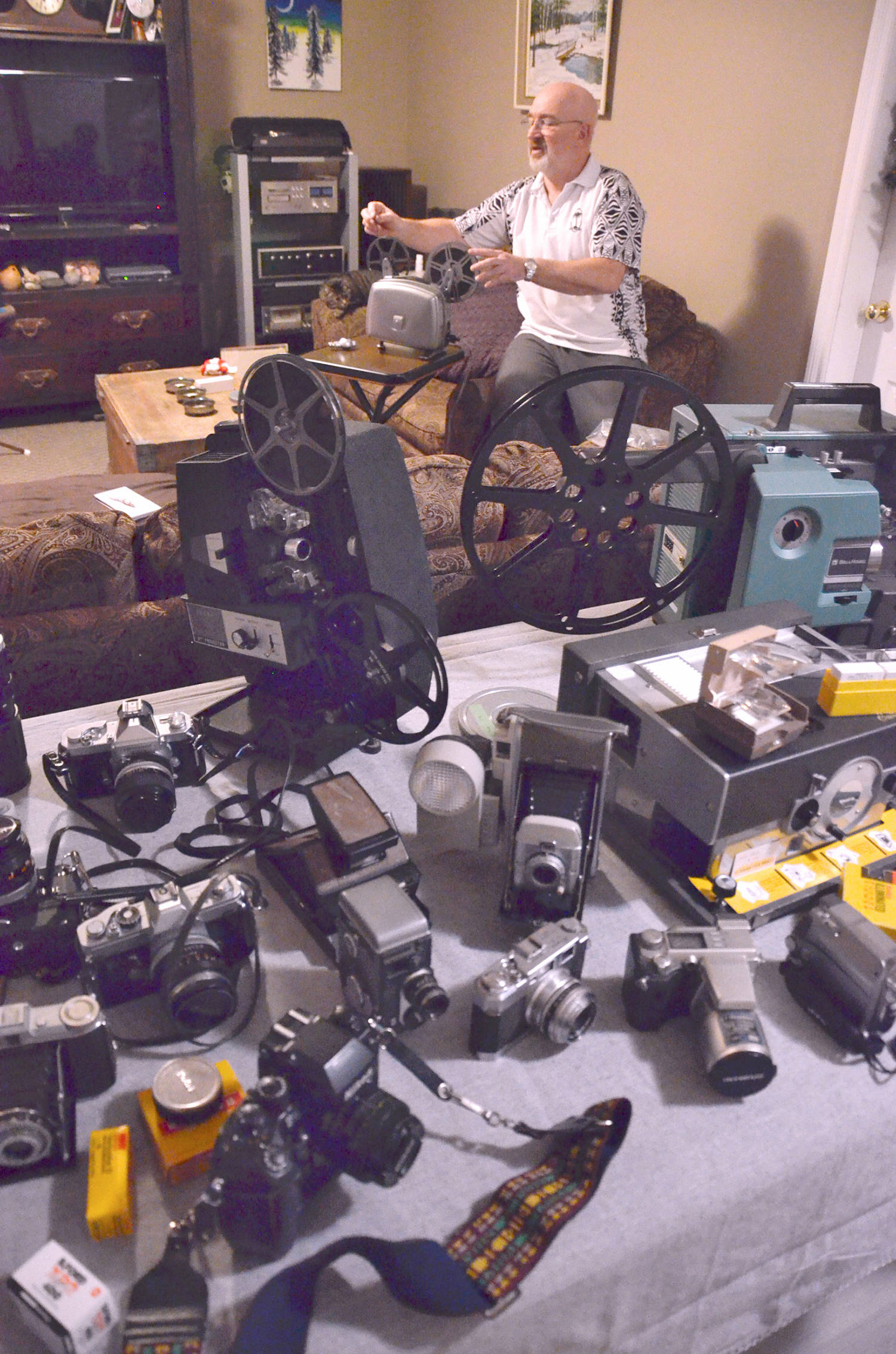 Mike Burgher's collecting has led him to find old slides, photos and home movies at thrift shops, garage sales and flea markets. Recently a thrift store purchase included a video of a baby's first year of life, and he was able to connect with the original owner. (Heather Colpitts/Langley Advance Times)