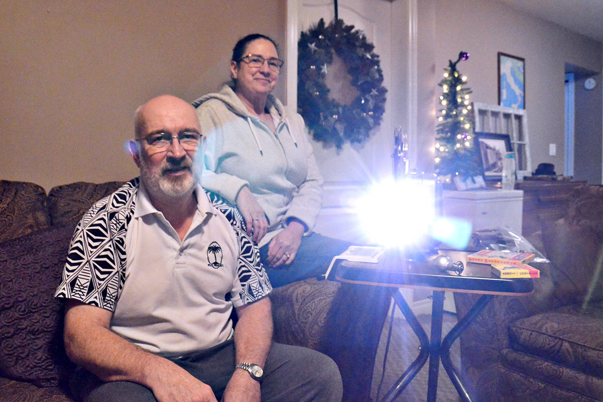 Mike Burgher recently found a family video in a used video camera and his fiancee Robyn Ciccone tracked down the original owner. They have come across some interesting old photos, slides and films since he started collecting audio/video equipment a few years ago. (Heather Colpitts/Langley Advance Times)