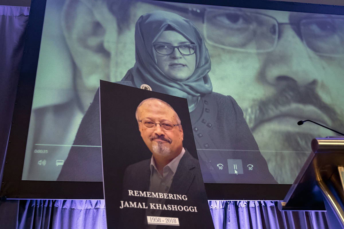 FILE - In this Nov. 2, 2018 file photo, a video image of Hatice Cengiz, fiancee of slain Saudi journalist Jamal Khashoggi, is played during an event to remember Khashoggi, who died inside the Saudi Consulate in Istanbul on Oct. 2, 2018, in Washington. A court in Saudi Arabia has sentenced five people to death for the killing of Washington Post columnist Jamal Khashoggi, who was murdered in the Saudi Consulate in Istanbul last year by a team of Saudi agents. Saudi Arabia's state TV reported Monday, Dec. 23, 2019 that three others were sentenced to prison. All can appeal the verdicts. (AP Photo/J. Scott Applewhite, File)