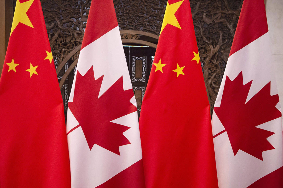 This Dec. 5, 2017, photo shows flags of Canada and China prior to a meeting of Canadian Prime Minister Justin Trudeau and Chinese President Xi Jinping at the Diaoyutai State Guesthouse in Beijing. China's embassy in Ottawa is taking a swing at the Trudeau Liberals over fresh comments on the source of the diplomatic difficulties between the two countries. THE CANADIAN PRESS/AP, Fred Dufour, Pool Photo