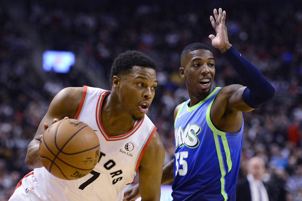 Toronto Raptors guard Kyle Lowry (7) moves past Dallas Mavericks guard Delon Wright (55) during first half NBA basketball action in Toronto, Sunday, Dec. 22, 2019. Lowry has been named the NBA's Eastern Conference player of the week. THE CANADIAN PRESS/Frank Gunn